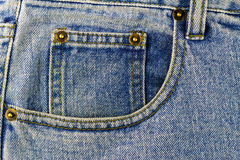 Front pocket of blue jeans, denim texture background Stock Photos