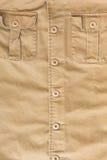 Front pocket on brown shirt textile texture Stock Photos
