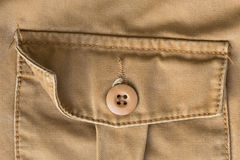 Front pocket on brown shirt textile texture Stock Image