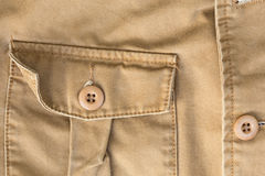 Front pocket on brown shirt textile texture Stock Images