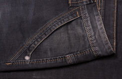 Front pocket of dark jeans close up Stock Photography