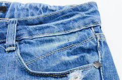 Front pocket with a seam on the blue jeans Royalty Free Stock Image