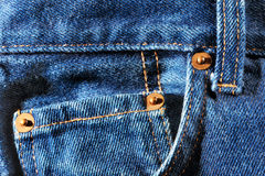 Front pockets on blue jeans Stock Photos