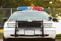 Front of police car with bumper. Front view of police car with siren and windshield Stock Photo