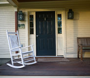 Front Porch. The front porch and rocking chair of a New England farm house royalty free stock photos