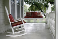 Front porch. With a rocking chair and a porch swing Stock Images