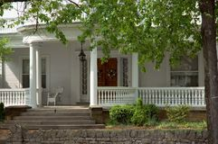 Front Porch. Elegant spindle details on this large front porch of an old Victorian home Stock Image