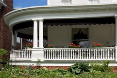 Front Porch. Large wrap around front porch with lots of detail work in the moldings and trim Royalty Free Stock Photo
