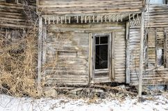Collapsing porch on abandoned farmhouse royalty free stock image