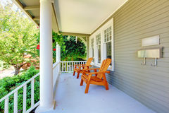 Front porch with chairs and columns. Front porch with chairs and columns of old craftsman style home Royalty Free Stock Image