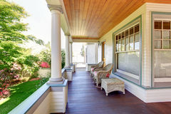Front porch with chairs and columns of craftsman home. Front porch with chairs and columns of craftsman style home Stock Photography