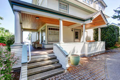 Front porch with chairs and columns of craftsman home. Front porch with chairs and columns of craftsman style home Royalty Free Stock Images