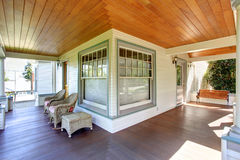Front porch with chairs and columns of craftsman home. Front porch with chairs, wooden bench and columns of craftsman style home Stock Photography