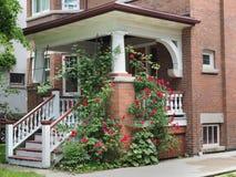 Front porch with climbing roses Stock Photos