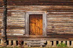 Front porch, door of old rustic log house or cabin Stock Photo