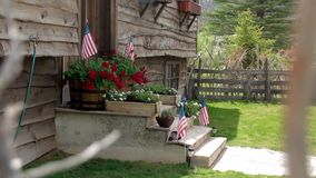 Front Porch of Home with American Flag stock video