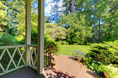 Front porch house exterior with summer garden. Northwest Stock Image