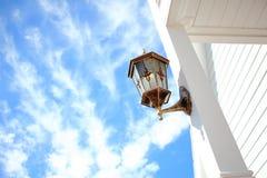 Front Porch Light Installed At vitpelare Royaltyfri Bild