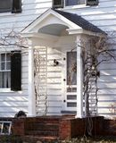 Front Porch - Older Home. Sunny view of a front porch during winter or early spring royalty free stock photos