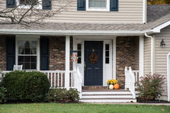 Front porch of resedential home with autumn decorations Royalty Free Stock Photos
