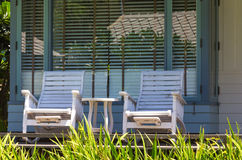 Front porch with rocking chair. In garden Stock Image