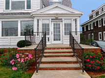 Front porch with rose bushe Royalty Free Stock Photo