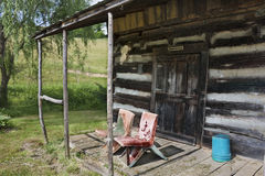 Front porch of rustic cabin Stock Images
