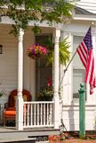 Front Porch with US Flag. Front porch of a small town home with a US Flag on Independence Day stock photography