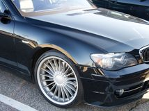 Front portion of a late model BMW Alpina car. Stock Photo
