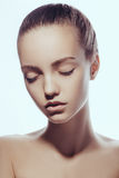 Front portrait of beautiful face with beautiful closed eyes - isolated on white. Close-up fashion portrait of young caucasian model with perfect skin. Photo of royalty free stock photography