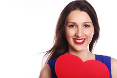 Front portrait of a beautiful young woman with long brown hair -. Posing at studio closeup.Love and valentines day woman holding heart smiling cute and adorable Stock Photo