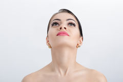 Front portrait of female neck on grey background close up. girl with clean and lifted skin Royalty Free Stock Images