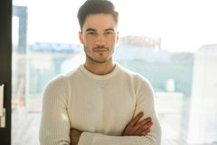 Young handsome man standing with crossed arms royalty free stock photo