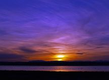 Front Range Sunset. This image of the colorful sunset was taken at Freezeout Lake in Montana Stock Photo