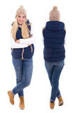 Front and rear view of beautiful blond woman in warm clothes pos Stock Image