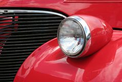 Front of a red 1930s car. Graphic-style image of partial front of a red automobile from the 1930s Stock Photography