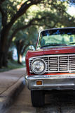 Front of Red Classic Ford Pickup Truck Parked on Street Next to Trees Stock Images
