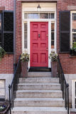Front red door that is secured royalty free stock photography