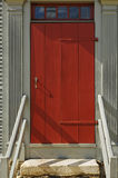 Front Red Door to a Building stock image