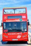 Tour bus parked at Blue Grotto, Malta. Front of a red open topped Maltese Tour Bus, Blue Grotto, Malta, Europe Royalty Free Stock Photos