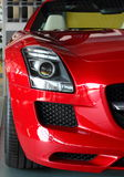 Front of red sports car. Closeup of the front of a shiny red sports car.  SLS 63 AMG Royalty Free Stock Image