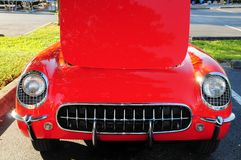 Front of red sports car hood up Royalty Free Stock Images
