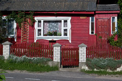 The front of red wooden house. Royalty Free Stock Image