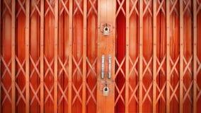Front Retro-Style Orange Extensible Door Securely Locked with Double Locks Stock Photo