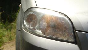 The headlight of the car flashes on the right side.