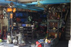 The historical second hand car parts store. The front of a roadside historical second hand car parts store in Taipei.The parts of scrap car will be checked Stock Image