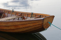 Front of a rowboat in calm water in the harbour Stock Images
