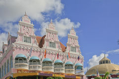 Front of Royal Plaza, Oranjestad, Aruba. The upper part of the pink Royal Plaza with the three towers and the dome of the pavilion on the right. Six verandas are Stock Images