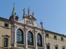 The front with sculptures of the St Vincent church. The facade of the church san Vicenzo (saint Vincent) on the piazza dei Signori in Vicenza in Italy royalty free stock photo