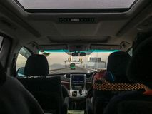 The front seat of the car and the view of the bridge over the sea outside looked from the back seat stock photos